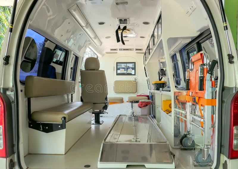 Inside an ambulance with medical equipment . Car for patient refer.  royalty free stock image