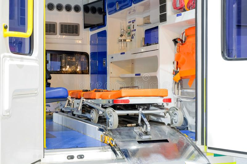 Inside an ambulance with medical equipment for helping. Patients before delivery to the hospital royalty free stock image