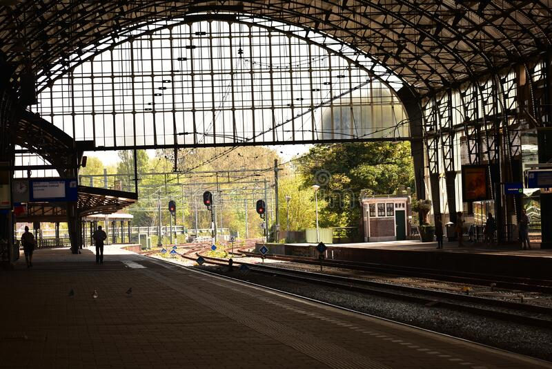 Inside of an Amsterdam train station on a sunny day stock photography
