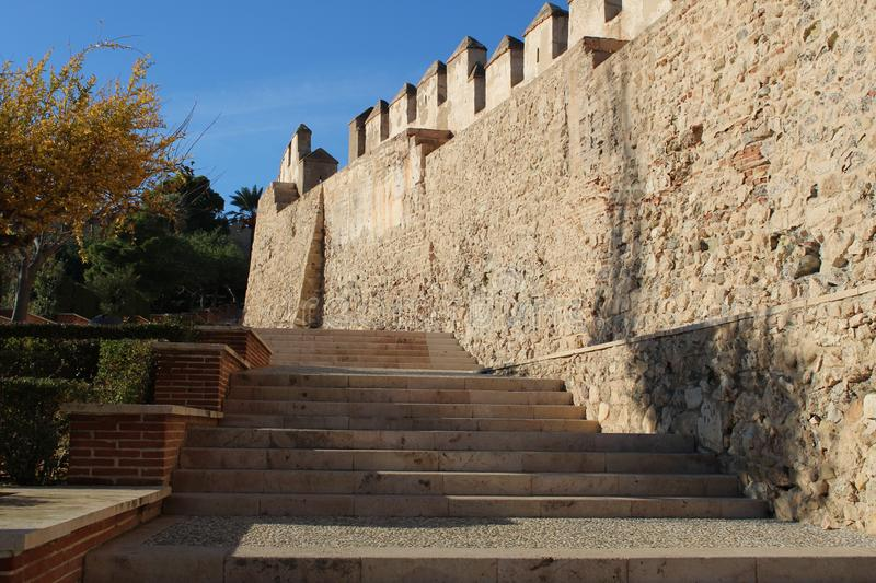 Inside of ancient castle. With stairs and gardens royalty free stock photography