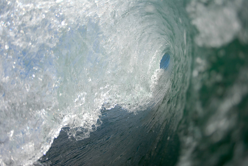 Inside a barreling wave stock images