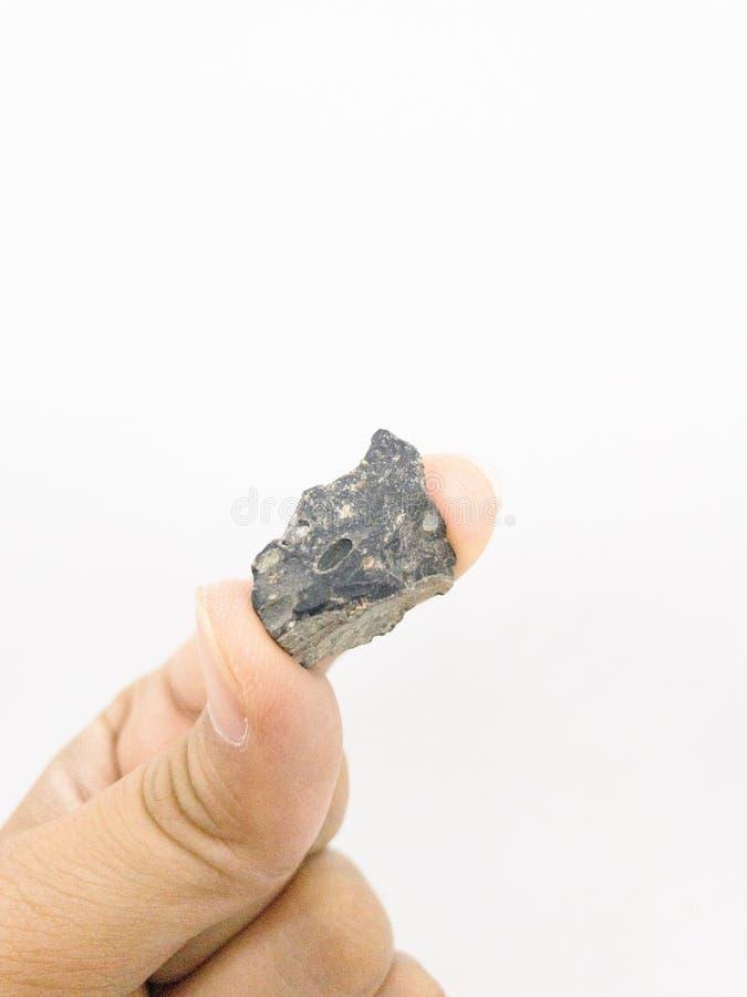 Inside basalt stone. Stone, basalt, granite, lava, lava cools down, fine-grained, porous, geology, hardness, dark, volcano stock photography