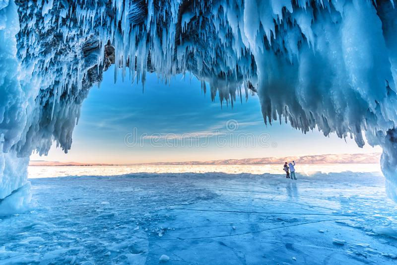 Inside the blue ice cave with couple love at Lake Baikal, Siberia, Eastern Russia royalty free stock image
