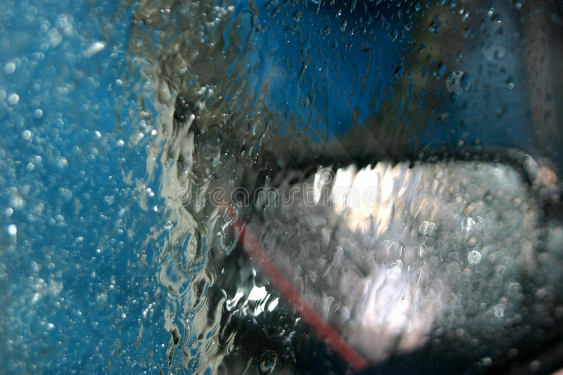 Inside a car wash. View of an automatic car wash from inside a car stock image