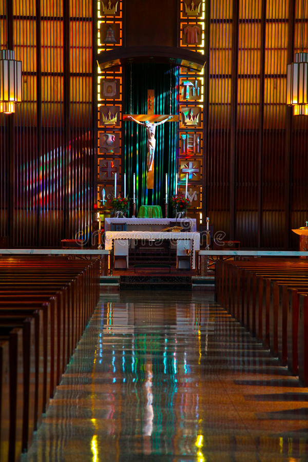 Inside of Catholic church. Sunlight shines on an alter of a Catholic Church royalty free stock image