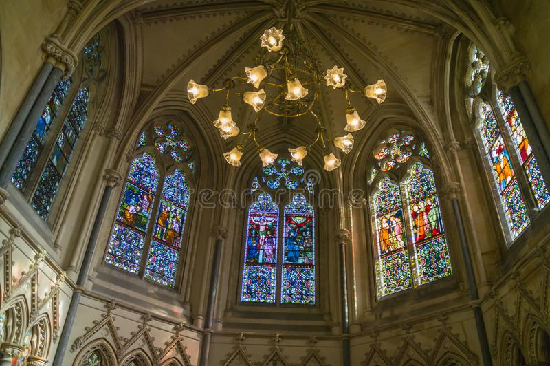 Inside the chapel at Tyntesfield stately home in Somerset. Showing sunlight filtering through the elaborate stained glass windows, a domed ceiling and an stock images