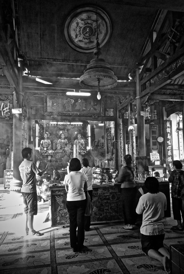 Inside of Chinese temple with a prayers. royalty free stock photos