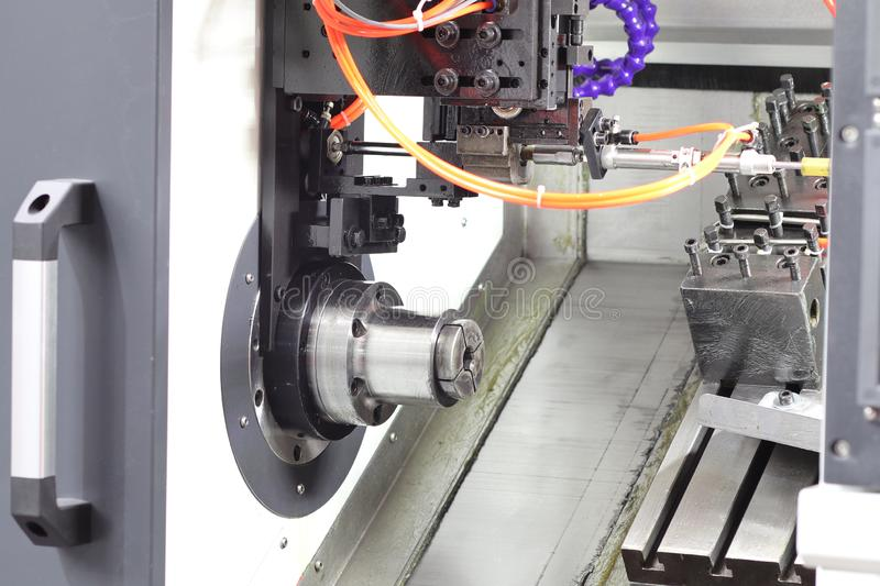 Inside CNC lathe machine. Without workload ; door open, shop, production, metal, cutting, turning, plant, technology, machining, equipment, industry, steel stock photography