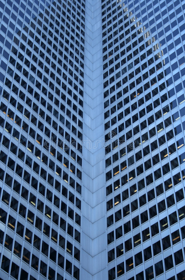 Free Inside Corner Of A Glass-windowed Office Tower Royalty Free Stock Image - 2103446