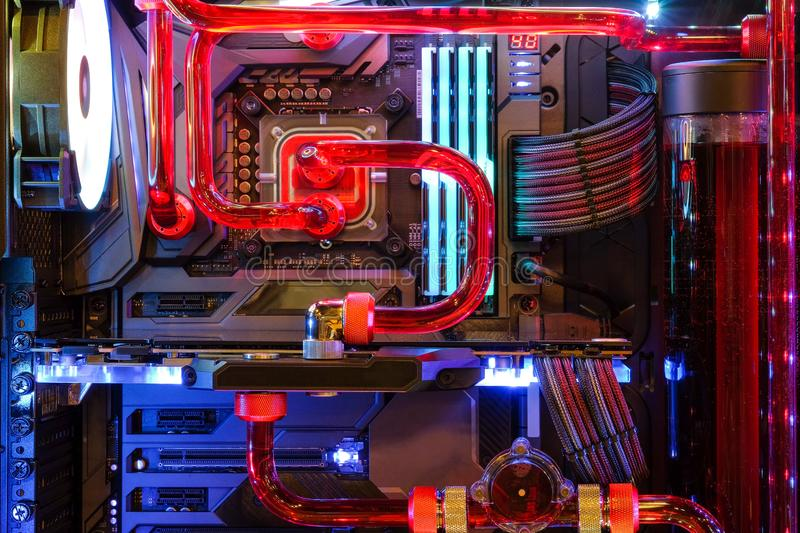 Inside Desktop PC Gaming and Water Cooling CPU with LED RGB light show status on working mode. Close-up and inside Desktop PC Gaming and Water Cooling CPU with stock photos