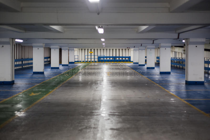 Inside of Empty Car Park at Night royalty free stock images