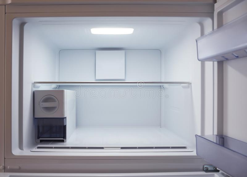 Inside of empty and clean modern refrigerator, freezer. Inside of empty and clean modern refrigerator stock image