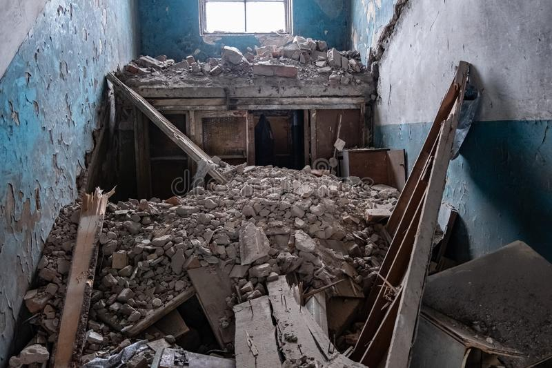 Inside empty destroyed building, collapsed walls and roof stock photos