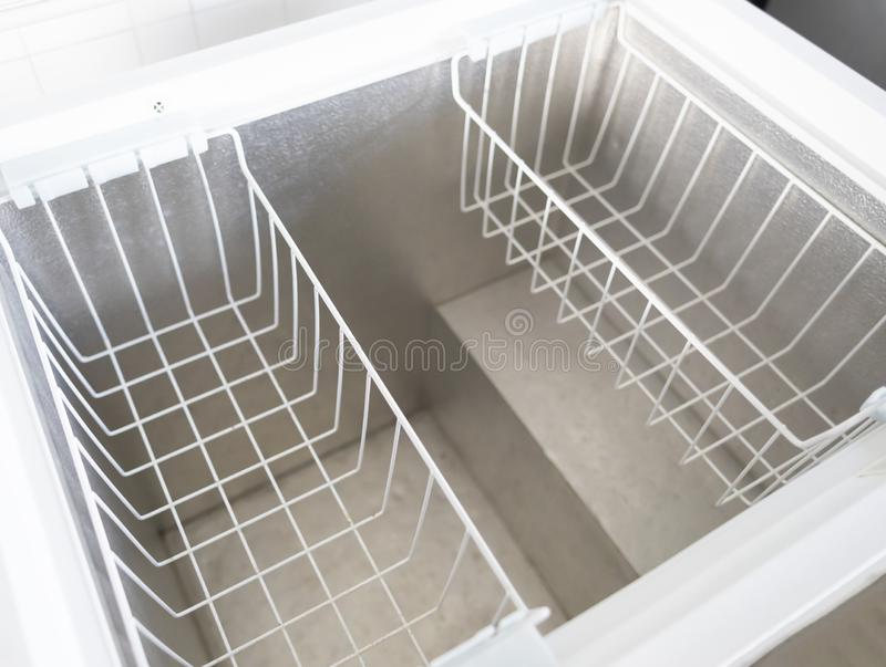 Inside Of An Empty Freezer With Two Baskets stock photos