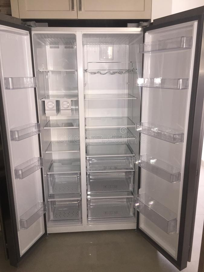 Inside of Empty Grey Double Door Fridge. Inside shelves of brand new refrigerator royalty free stock image