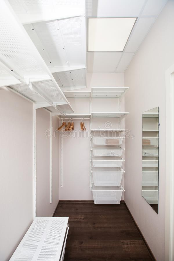 Inside of the empty white walk-in wardrobe. Close up stock images