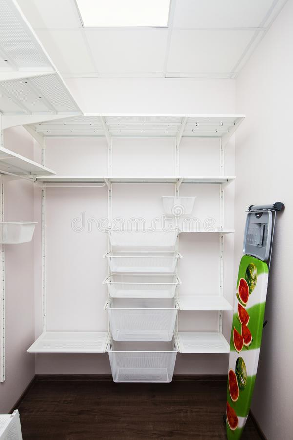 Inside of the empty white walk-in wardrobe. Close up stock photography