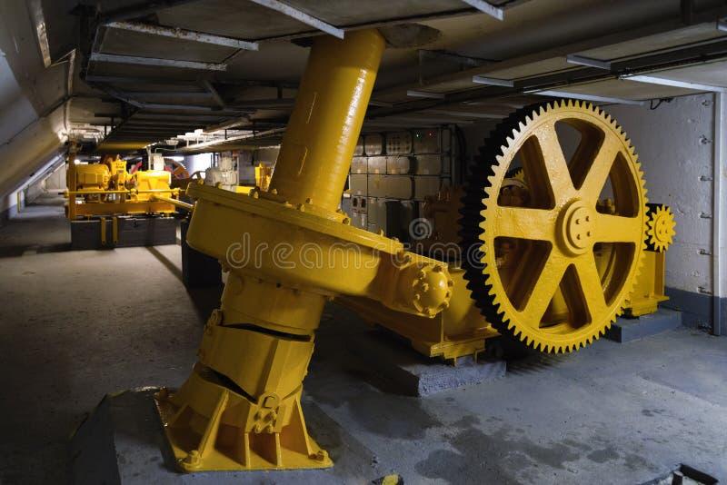 Big yellow cogwheel. Inside factory - big yellow cogwheel machinery royalty free stock photo