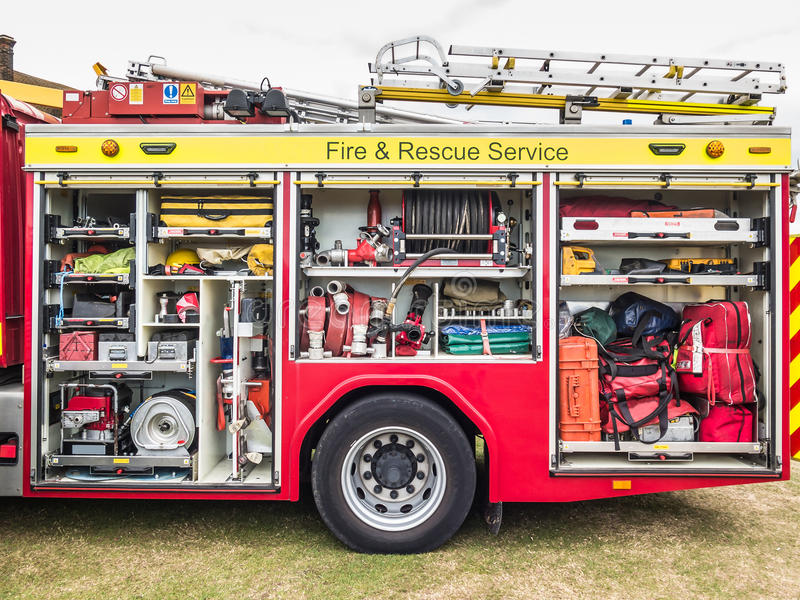 Inside the fire engine, fire truck. The side view of equipment packed neatly inside a fire engine, fire truck royalty free stock photo
