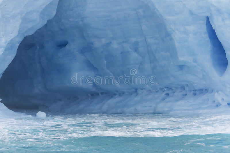 Inside glacial iceberg. Inside cavern on blue glacial iceberg in Antarctica royalty free stock photo