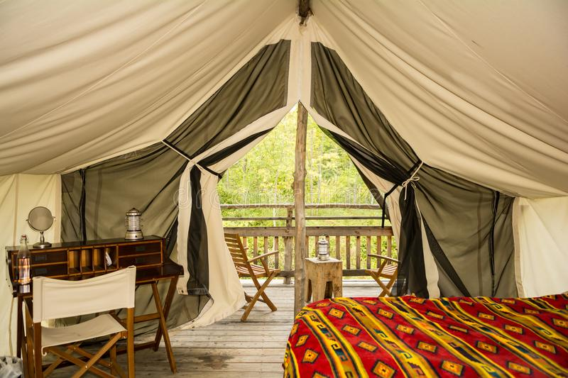 Glamping in New York. The inside of a glamor camping tent in New York State stock images