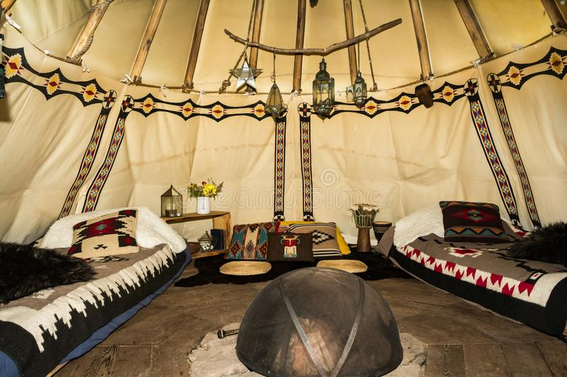 The inside of a Glamping Teepee. A glamour camping teepee in a farm field in New York State royalty free stock image