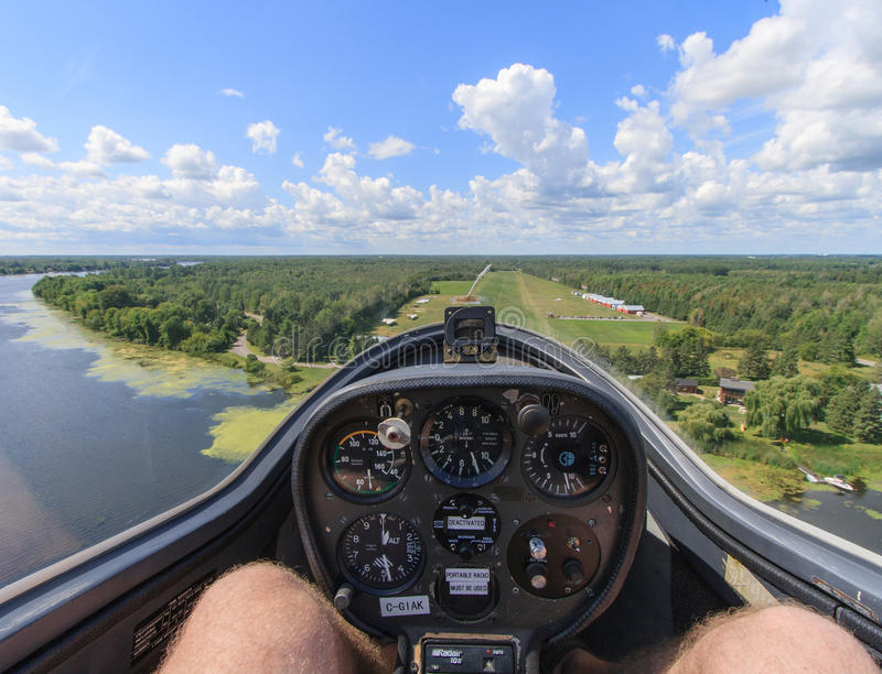 Inside a Glider Approaching Airstrip. MANOTICK, CANADA – AUGUST 19: The view from the front seat of a glider approaching Rideau Valley Soaring on August royalty free stock photography