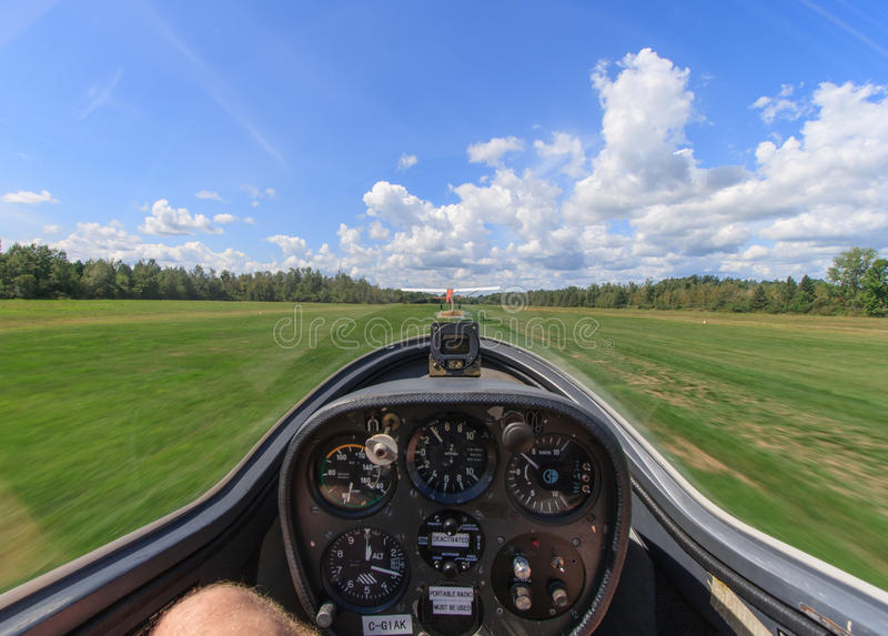 Inside a Glider During Takeoff. The view from inside a glider as it is being towed by another plane down a grass airfield in Manotick, Ontario, Canada stock photography