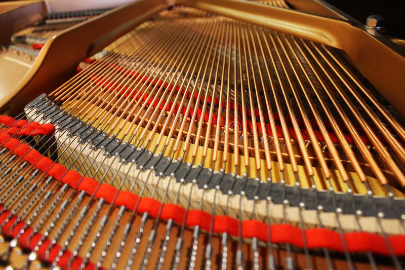 The inside of a Grand Piano stock photography