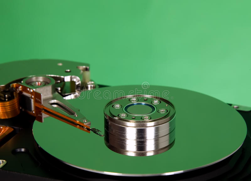 Download Inside Of Hard Disc  On Green Background Royalty Free Stock Image - Image: 20588486