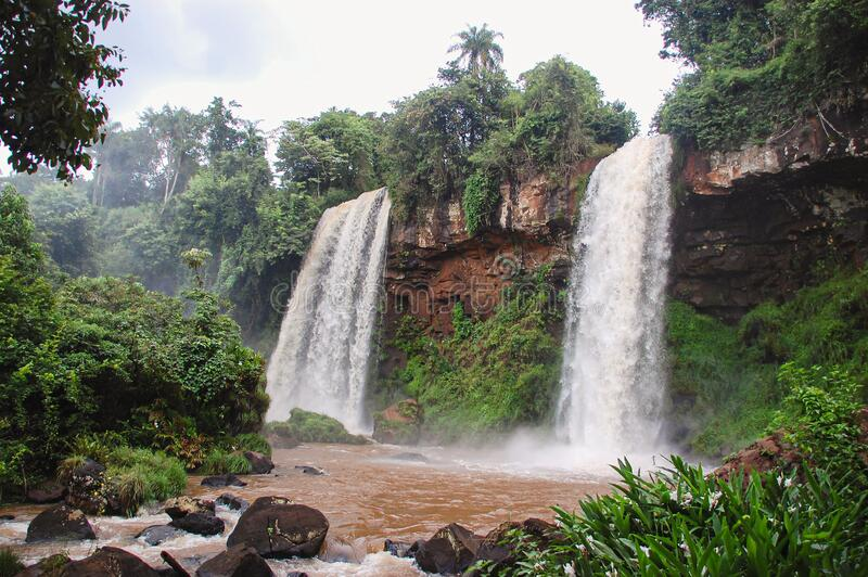 View of two waterfalls in Iguazu. Inside the Iguazu national park in Argentina, view of two waterfalls surrounded by the rain forest. Jungle landscape of two royalty free stock photos
