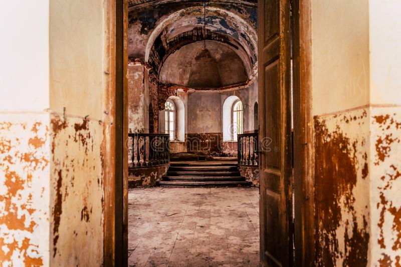 Inside Interior of an old Abandoned Church in Latvia, Galgauska - light Shining Through the Windows. Colorful Brown Theme stock photography