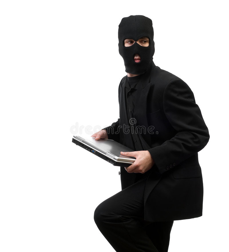 Inside Job. A business thief from inside a corporation is stealing company secrets, isolated against a white background royalty free stock photography