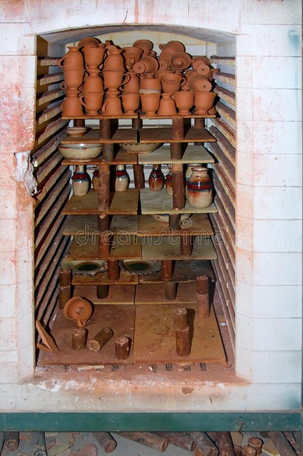 The inside of a kiln. With ceramic workpieces stock photos