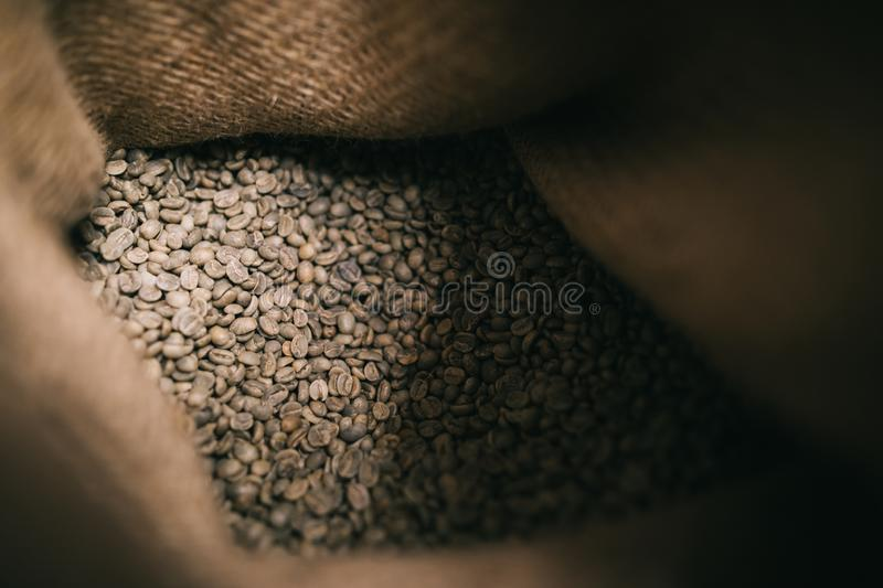 Inside look go unroasted beans in gunny sack royalty free stock photos