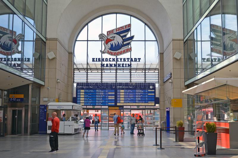 Inside of Mannheim main station with blue digital train arrival and departure time table stock photography