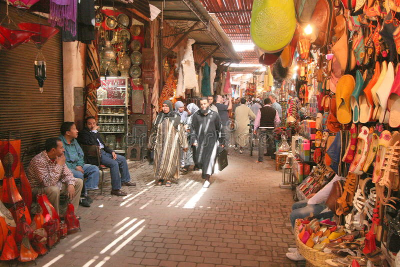Inside the Marrakesh souk. People wandering through the souk in Marrakesh, Morocco royalty free stock images