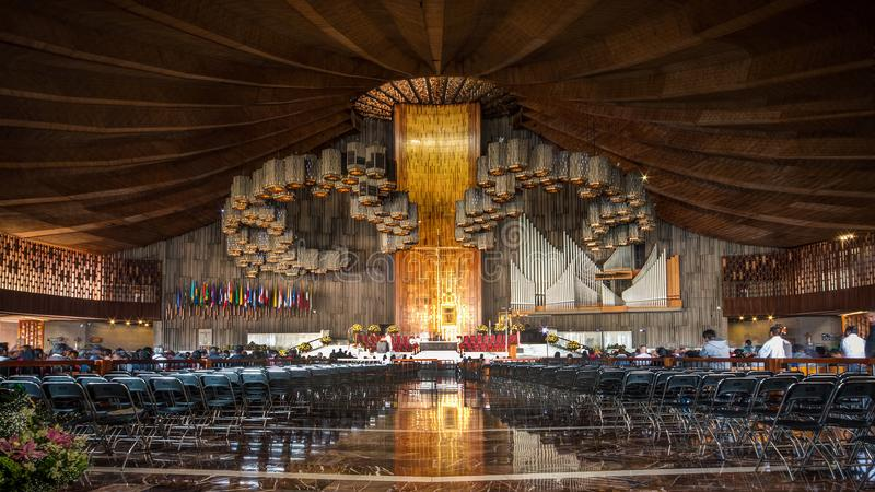 Inside the massive new Basilica of Our Lady of Guadalupe, Mexico City. Parishioners gather for mass at the new Basilica of Our Lady of Guadalupe, located in the royalty free stock images