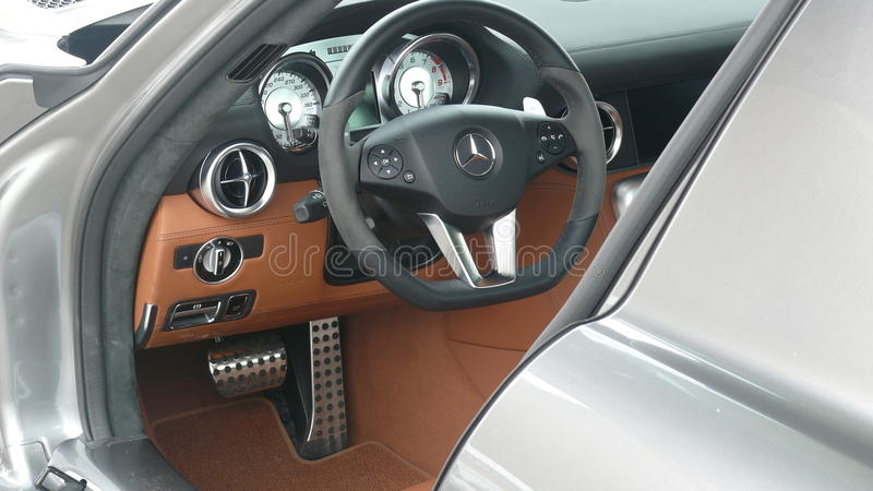 Inside of a Mercedes Benz SLS AMG 6.3. Lima, Peru. May 14, 2011. Side close up view of a silver color with beige leather gullwing Mercedes Benz SLS AMG 6.3 royalty free stock image
