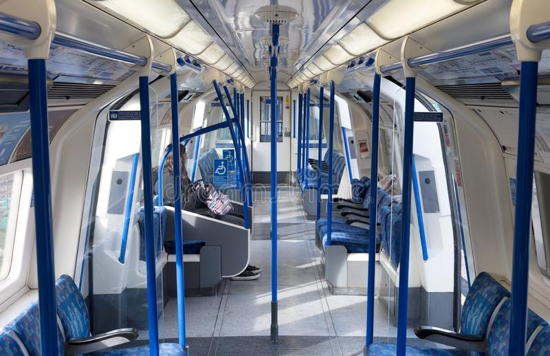 Inside of a metro coach on Februari 22, 2019 in London. London Underground is the 11th busiest metro system. London - Februari 22: Inside of a metro coach on royalty free stock photo