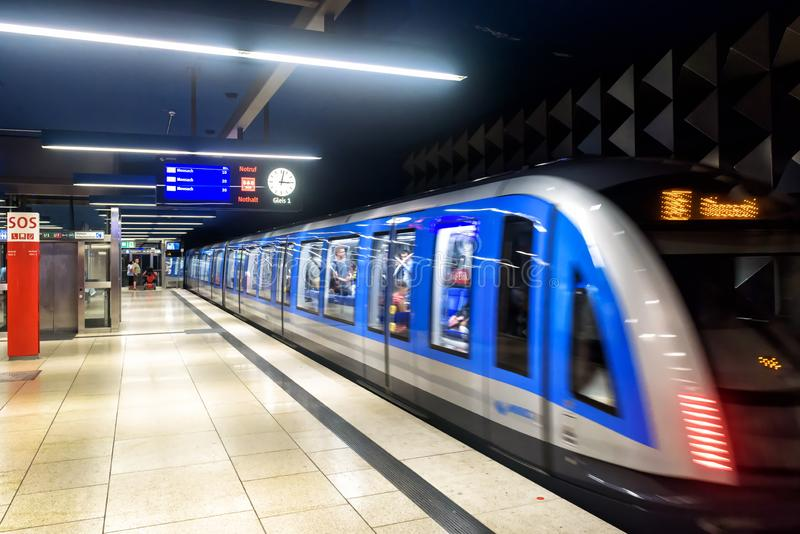 Inside the metro station in Munich. Train movies in modern subway. Munich, Germany - Aug 2, 2019: Inside the metro station in Munich. Train movies in modern royalty free stock images