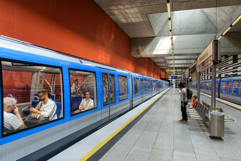 Inside the metro station in Munich. Train with passengers in modern subway. Munich, Germany - Aug 2, 2019: Inside the metro station in Munich. Train with royalty free stock photo