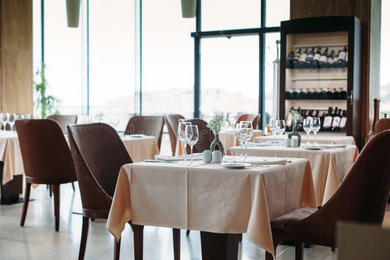Inside modern restaurant. Table setting inside modern restaurant stock photography