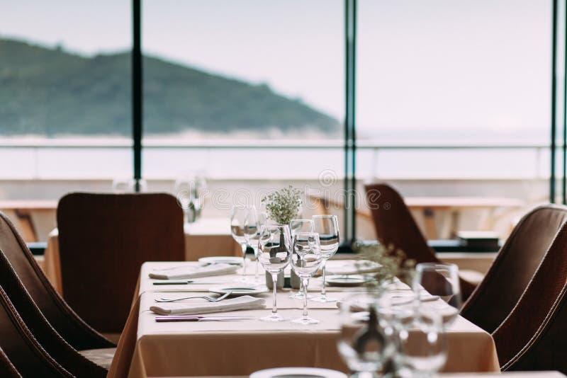 Inside modern restaurant. Table setting inside modern restaurant royalty free stock images