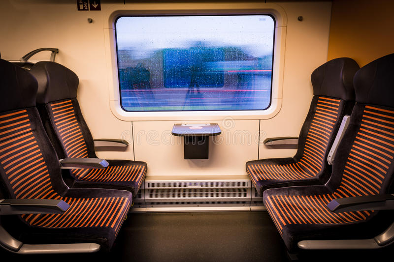Inside modern train looking out of the window stock image