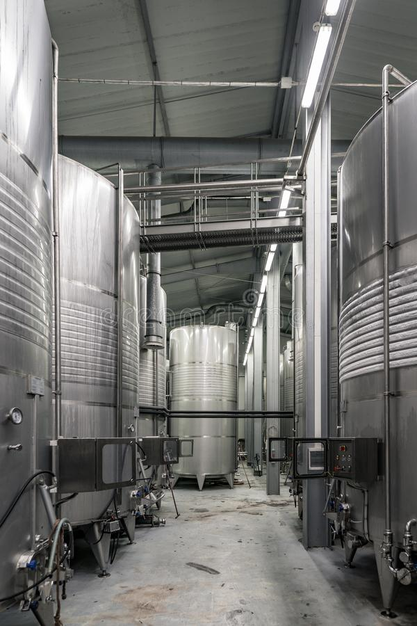 Inside of a modern winery with controlled temperature wine barrels. New world wine making industry photography shoot in a modern winery stock photos