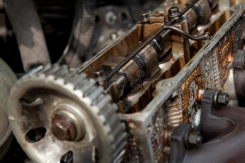 Inside old car engine on scrap yard royalty free stock photography