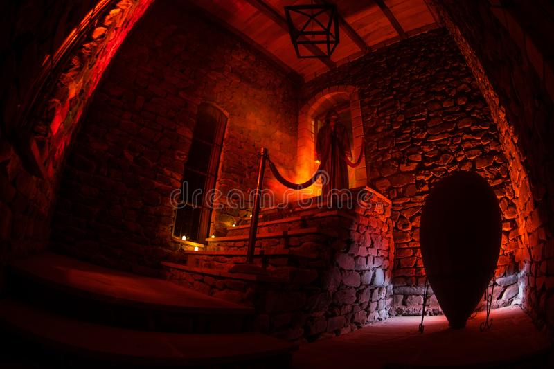 Inside of old creepy abandoned mansion. Staircase and colonnade. Silhouette of horror ghost standing on castle stairs to the royalty free stock photos