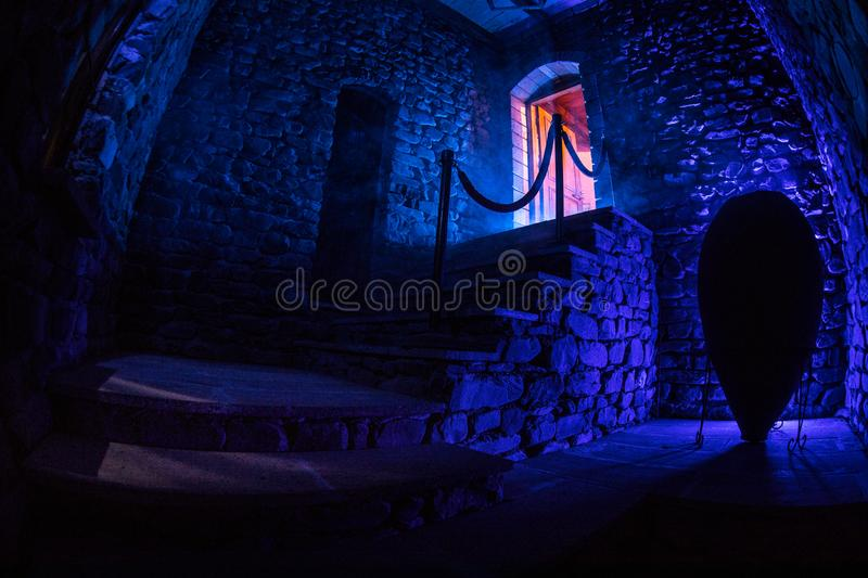 Inside of old creepy abandoned mansion. Staircase and colonnade. Dark castle stairs to the basement. Spooky dungeon stone stairs i royalty free stock photo