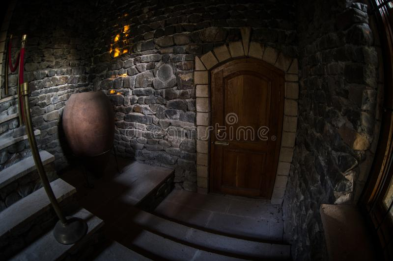 Inside of old creepy abandoned mansion. Staircase and colonnade. Dark castle stairs to the basement. Spooky dungeon stone stairs stock images